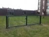 Dubbele tuinpoort met staalmatvulling